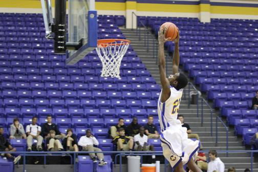 Cameron Grant goes for the dunk.