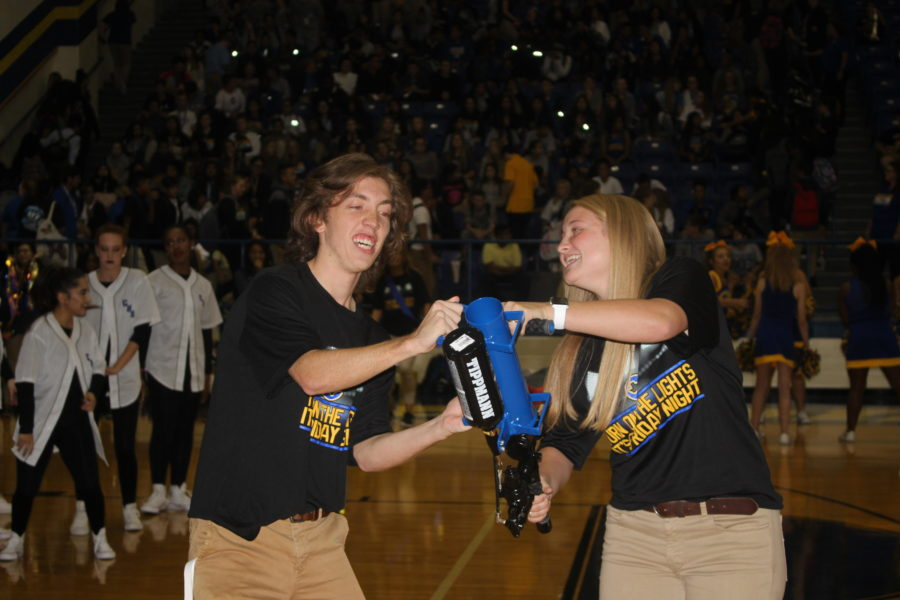 Corbin Hill and Allison Spence are getting ready to shoot Corsicana's new ''Turn on the lights its Friday night'' T shirts in the stands at the pep rally