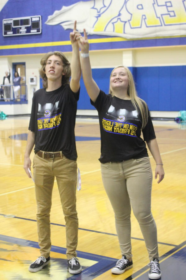 Corbin Hill and Allison Spence are side by side singing the Corsicana traditional school song together.