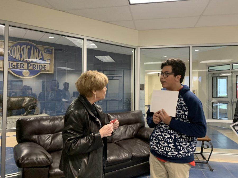 2nd Place winner Christian Cuellar is presented his certificate from Pen to Lens Director Lynda Green.